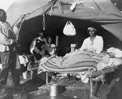 1927 photo African Americans in front of tent, with one man sitting up