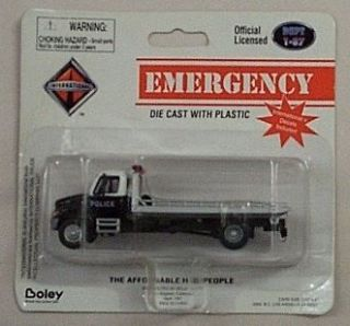 87 Die Cast Intl Police Black & White Roll Off On Flatbed Tow Truck