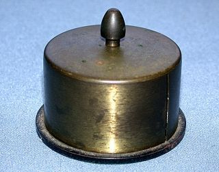 Brass Roll Stamp Dispenser With Lots of Patina & Green Felt Bottom