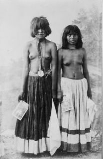 1909 photo Two bare breasted Yuma women posed, standing, full length