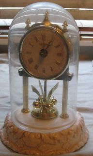 ceramic base Anniversary Clock w/glass dome 4 ball pendulum 8 inc