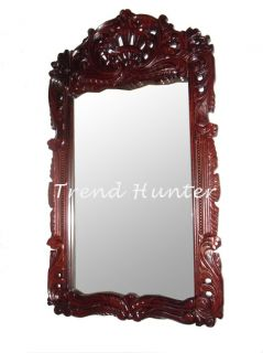 description decorative wall mirror in antique carved wood frame