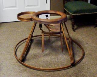 old 1800s brown wooden baby seat walker