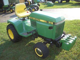 1991 John Deere 318 garden tractor w 3PT weights and 26 bar tires
