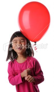 Smiling Girl Holding a Red Balloon Royalty Free Stock Photo