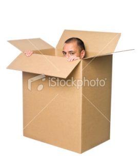 stock photo 10511915 man in a cardboard box