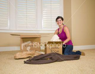 stock photo 4316292 woman unpacking boxes