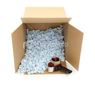 Cardboard Box and Shipping Peanuts Royalty Free Stock Photo