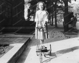 young girl riding antique tricycle 1920 vintage 8x10 reprint of
