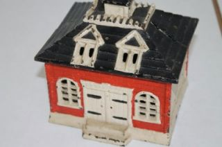 antique vintage cast iron coin bank building