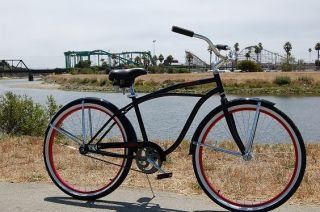 black beach cruiser bike, red rims, fenders, single speed bicycle coas