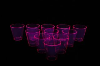 50 Count Neon Pink Blacklight Reactive Plastic Shot Glasses