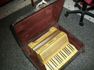 Used piano accordion with case; chord buttons work but keyboard does