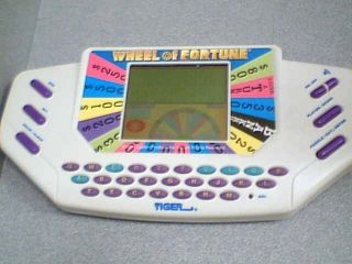 1995 CALIFON PRODUCTIONS, INC TIGER ELECTRONICS WHEEL OF FORTUNE LCD