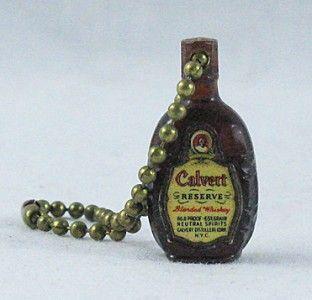 vintage calvert whiskey keychain charm advertising
