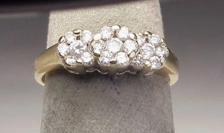 this ring is finely crafted from 14k two tone gold with three approx