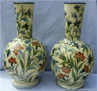 Lambeth Faience Vases. Hand painted by Minna L Crawley. Dated 1871