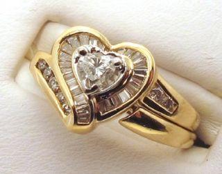 Diamonds Center 0 25ct VS2 Sides 0 25ct VS2 14k Yellow Gold Heart