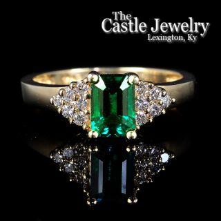 Emerald Cut Emerald and Diamond Ring.  12 Diamonds .25 CTTW   14k