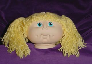 Vintage 1984 Doll Baby Head Blue Eyes and Yellow Yarn Hair in Pigtails