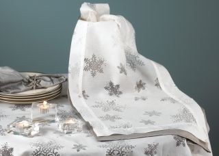 This beautiful table runner features a burnout voile snowflake design