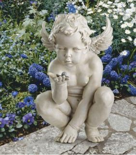 curious cherub angel statue garden winged sculpture