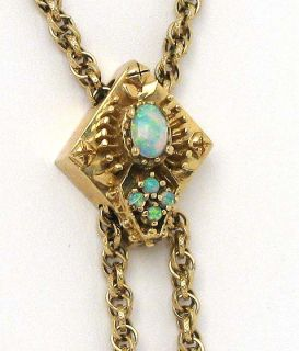 this is a ladies 14k gold and gems slide charm tassel necklace