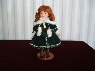 Geppeddo Doll 13 Tall Dressed in Green with Flaux Fur Red Hair Green