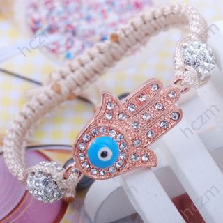 white crystal pave ball rose gold tone hand evil eye beige cord string
