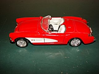 Red 1957 Corvette with Opening Doors Hood Damaged Windshield Frame