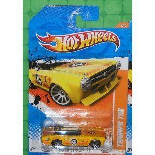 70/244)   Track Stars 11 (5/15)   Triumph TR6 (Yellow): Toys & Games