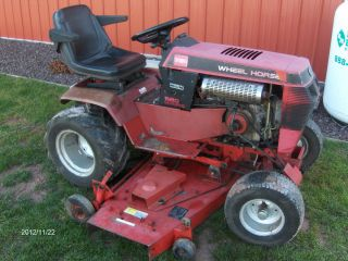 Toro Wheel Horse 520H with 60 Mower Deck and 48 Dozer Blade