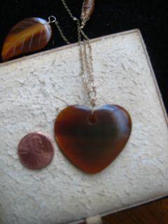 jami rodriquez burnished wood, heart, & leaf assymetrical gold chain