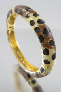 You are bidding on a KENNETH JAY LANE Giraffe Bangle Bracelet. This is