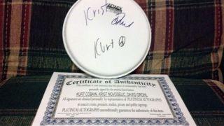autographed drumhead (Kurt Cobain, Krist Novoselic, Dave Grohl) w/ COA