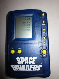 MGA Entertainment Space Invaders Electronic Handheld Travel Game 1997