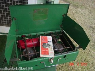 1965 Coleman camp stove camping gear gas fuel Canada tent green red