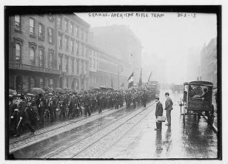 Photo: German America n Rifle Team,in parade,New York,NY,umbrel las