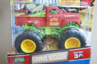 HOT WHEELS MONSTER JAM TRUCK GRAVE DIGGER EDGE GLOW Red Truck with