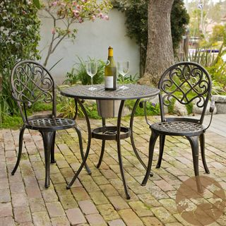 Christopher Knight Home Angeles Cast Aluminum Outdoor Bistro Furniture Set With Ice Bucket (CopperSturdy constructionNeutral colors to match any outdoor decorIdeal for entertaining guests outsideConvenient ice bucket is perfect for cooling drinksHole has
